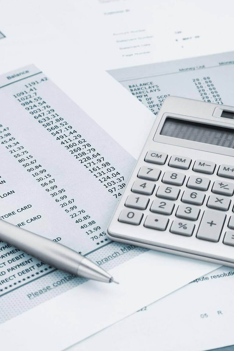 A calculator and credit card statements